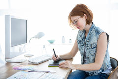 Hipster businesswoman drawing on her tablet Stock Photos