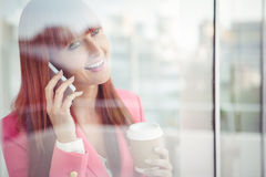Hipster businesswoman having a phone call Stock Photos