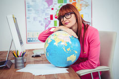 Hipster businesswoman lean on a globe Stock Photo
