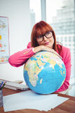 Hipster businesswoman lean on a globe Stock Images