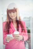 Hipster businesswoman texting with her smartphone Stock Image