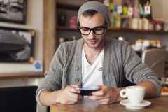 Hipster at cafe Royalty Free Stock Photography