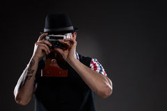 Hipster in checkered shirt taking the picture Stock Photography