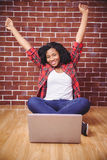 Hipster cheering and using laptop Royalty Free Stock Images