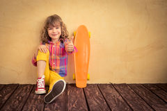 Hipster child with skateboard Royalty Free Stock Photo