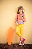 Hipster child with skateboard Stock Photos