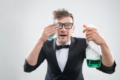 Hipster cleaning his glasses Stock Photos