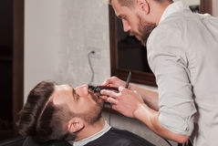 Hipster client visiting barber shop Royalty Free Stock Photography