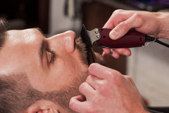 Hipster client visiting barber shop Royalty Free Stock Images