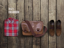 Hipster clothes and accessories on a wooden background Royalty Free Stock Photos