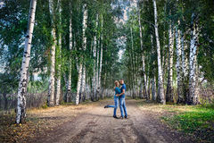 Hipster couple in the birch wood Royalty Free Stock Photos