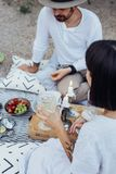 Hipster couple drinks wine on picnic Stock Photo