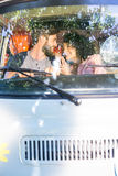 Hipster couple driving in camper van Royalty Free Stock Image