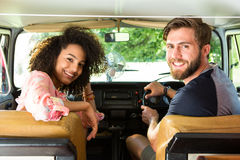 Hipster couple driving in camper van Stock Image