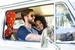 Hipster couple driving in camper van Stock Photography