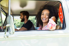 Hipster couple driving in camper van Royalty Free Stock Photo