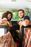 Hipster couple driving in camper van Stock Photo