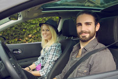 Hipster couple driving car, retro style Royalty Free Stock Photography