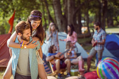 Hipster couple having fun on campsite. At a music festival stock images