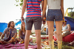 Hipster couple holding hands on campsite Stock Photos