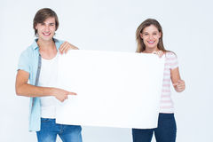 Hipster couple holding poster Stock Photos