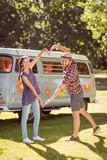 Hipster couple making heart with arms Royalty Free Stock Image