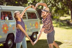 Hipster couple making heart with arms Stock Image