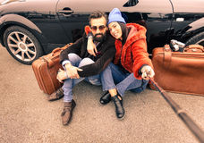 Hipster couple making selfie with stick Stock Images
