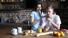 Hipster couple relaxing in the kitchen in morning stock video