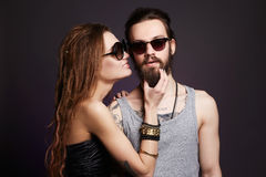 Hipster couple in sunglasses. Fashion beautiful happy couple in sunglasses.Hipster boy and girl Stock Photo