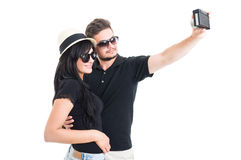 Hipster couple taking a selfie with retro vintage camera Royalty Free Stock Photos