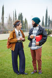 Hipster couple talking and drinking coffee to go Stock Image