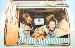 Hipster Couple With Cute Dog Traveling Together On Vintage Mini Van Royalty Free Stock Photos