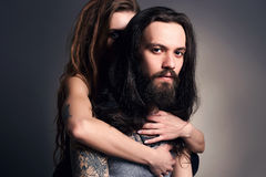Hipster couple.woman and man in hugs Royalty Free Stock Photos