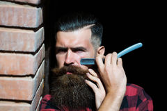 Hipster cutting with razor Stock Images