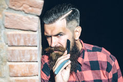 Hipster cutting with razor Stock Image