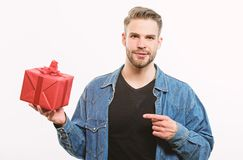 Hipster denim shirt hold gift box white background. Love and romantic feelings concept. Man with beard and happy face stock photo