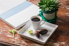 Hipster easter. Flat lay photography: cup of coffee, chocolate egg, old magazine, succulent cactus and vintage napkin in Royalty Free Stock Image
