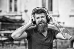 Hipster enjoy high quality sound of song in headphones. Get music subscription. Enjoy free songs everyday. Excellent. Music in his playlist. Man bearded hipster stock image