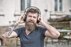 Hipster enjoy high quality sound of song in headphones. Get music subscription. Enjoy free songs everyday. Excellent. Music in his playlist. Man bearded hipster stock photo