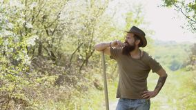 Hipster farmer relaxing at nature background. Eco farm worker. American farm life. Ecology concept. Man with beard - stock video