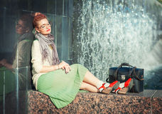 Hipster fashion girl in green skirt Stock Photography