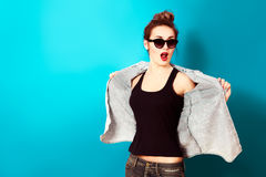 Hipster Fashion Girl on Turquoise Background Royalty Free Stock Photography