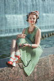 Hipster fashion hipster girl in green dress listening music Royalty Free Stock Photography