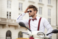 Hipster fashion men with scooter Stock Photo