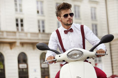 Hipster fashion men with scooter stock photos