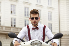 Hipster fashion men with scooter Royalty Free Stock Images