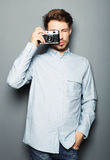 Hipster fashion photographer man holding retro camera Stock Images