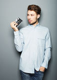 Hipster fashion photographer man holding retro camera Royalty Free Stock Photos