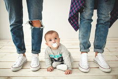 Hipster father, mother and baby boy on rustic wooden floor Royalty Free Stock Image